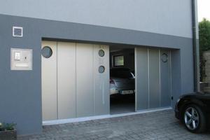 Opsomer & Delmotte sprl - Portes sectionnelles latérales